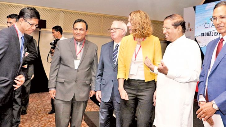 President Maithripala Sirisena who yesterday vowed to place Sri Lanka in the number one position among countries in the world fighting against corruption during his speech at the Global Expert Group Meeting on the Jakarta Principles in Colombo, stressing a point during a discussion with some of the delegates. Picture by Saman Sri Wedage