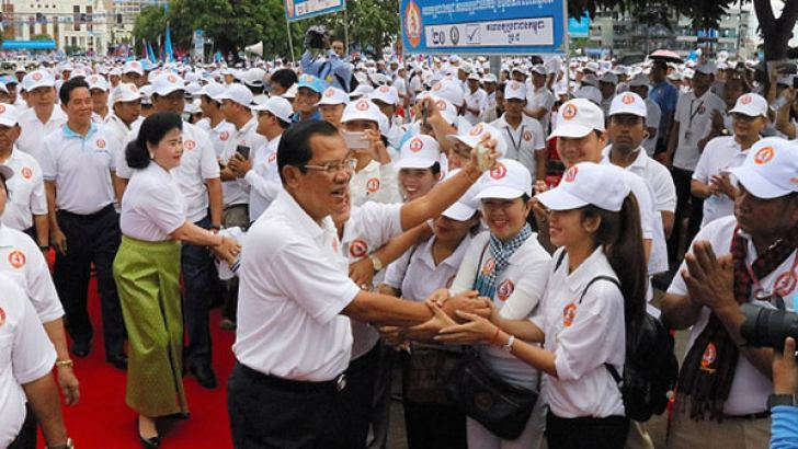 Cambodian Prime Minister Hun Sen greeting supporters on the final day of the election campaign. - AFP