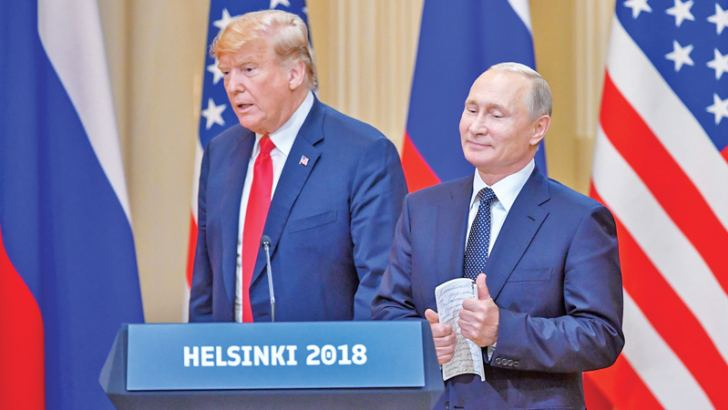 US President Donald Trump and Russia's President Vladimir Putin arrive to attend a joint press conference after a meeting at the Presidential Palace in Helsinki, on July 16. - AFP