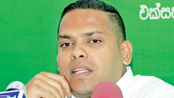 Minister Harin Fernando speaks at the media conference at the UNP headquarters yesterday. Picture by Roshan Pitipana