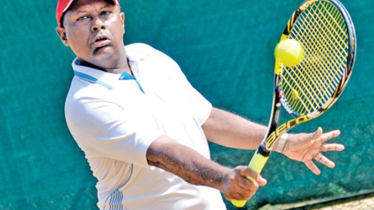 Suresh Subramaniam plays a back hand in men's Over 55 singles first round match against India's P. R. Raju