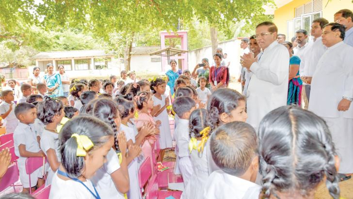 President Maithripala Sirisena speaking to children after opening a school building at Sirimavo Bandaranaike Primary School, Medirigiriya, on Wednesday under the Pibidemu Polonnaruwa programme. Picture by Sudath Silva