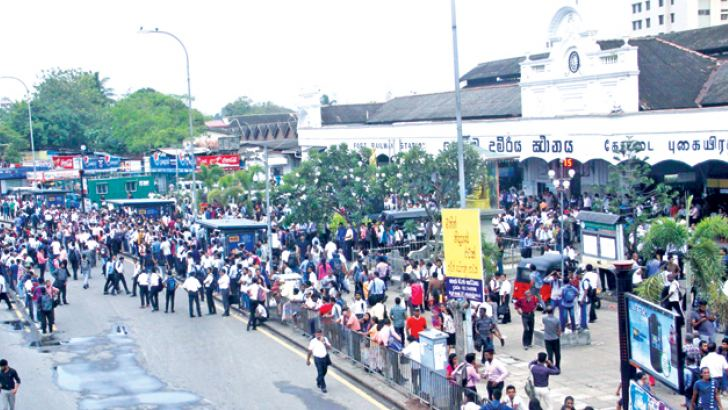 Stranded passengers outside the Colombo Fort Railway Station on Wednesday evening, after railway trade unions struck work. Pictures by Rukmal Gamage, Sudam Gunasinghe, Chaminda Niroshana and Malan Karunarathne