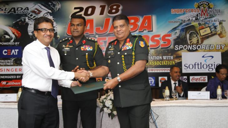 The official documents of the sponsorship handed over to Adjutant General of the Sri Lanka Army and Colonel of the Regiment Major General Shavendra Silva (right) by CEO, Softlogic Holdings Nasser Majeed (left). Center Commandant of Gajaba Regiment Colonel Harendra Peries is also in the picture (center). Picture by Rukmal Gamage