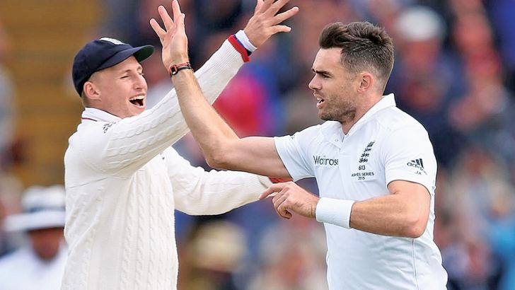 England captain Joe Root (left) celebrates a wicket with James Anderson.