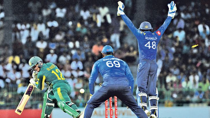 South African acting captain Quinton de Kock is castled by Sri Lanka's Akila Dananjaya for 57 in the fifth and final ODI played at the R Premadasa Stadium on Sunday. – AFP