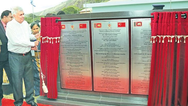 Prime Minister Ranil Wickremesinghe unveils a plaque to open the greater Kurunegala water supply and sanitation project in Kurunegala on Monday. (Picture by  PM's Media Unit)
