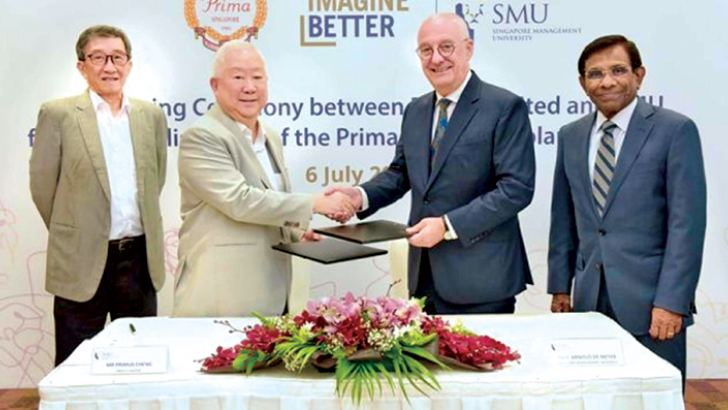 Prima Limited Chairman and CEO Primus Cheng and SMU President Professor Arnoud De Meyer exchanging the gift agreement.