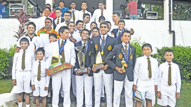 Champion Royal college sailors with their trophies