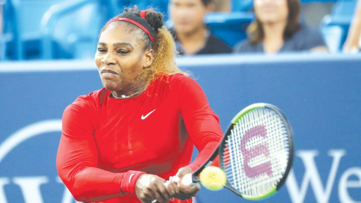 Serena Williams of the United States returns a shot against Daria Gavrilova of Australia during Day 3 of the Western and Southern Open at the Lindner Family Tennis Center on August 13, in Mason, Ohio. AFP