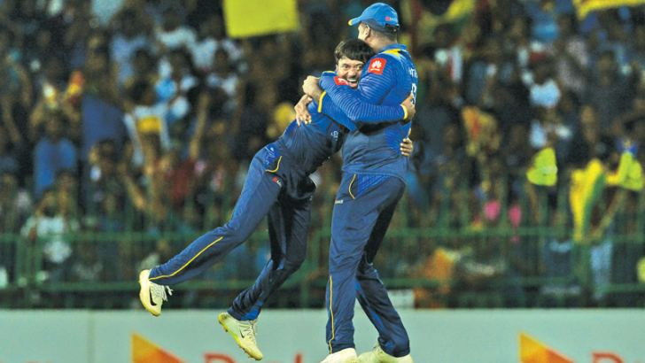 Akila Dananjaya gets a hug from his captain Angelo Mathews after dismissing South Africa's David Miller.  AFP