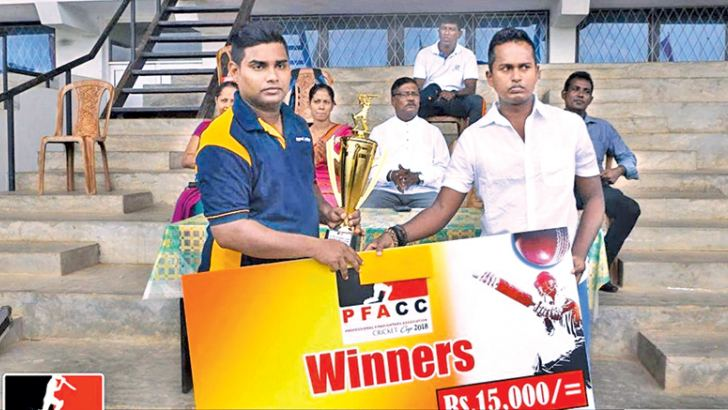 Champion Hambantota Port fire unit captain receivs the trophy and cash award