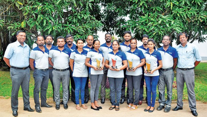 The victorious Total Quality Management (TQM) Team at Eskimo Fashion Knitwear, Sumith Samaradiwakara, Manjula De Silva, R.I. Madurasighe, D.A.B.M. Athapaththu, Gangani Dhananjanee, Harshika Dilanthi, Poornima Thamel, R.M.D.S. Bandara, L. Bernad Jason, Christopher Jayasundara, Harrington Praxhid,  J.P. Roncali Miranda, Piyal Chandima, Nimal Ranjith, Dinushan Charuka and Udaya Kumara.