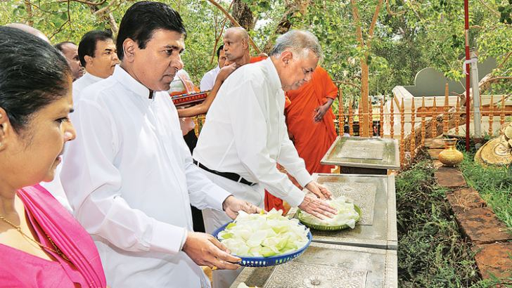 Prime Minister Ranil Wickremesinghe, Higher Education and Cultural Affairs Minister Dr. Wijeyadasa Rajapakshe and Women and Child Affairs Minister Chandrani Bandara taking part in religious activities.