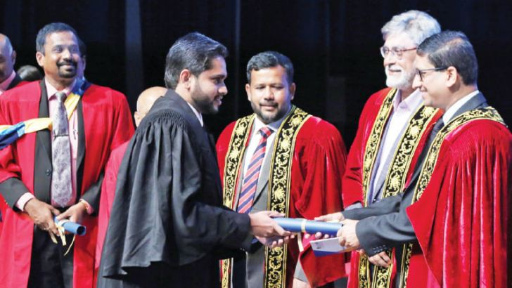 High Commissioner of Bangladesh to Sri Lanka Riaz Hamidullah presents a certificate to a SLITA student. Minister Rishad Bathiudeen, Chairman JAAF, Sharad Amalean and SLITA Director General, Eng. A. Robert V. Peries look on.