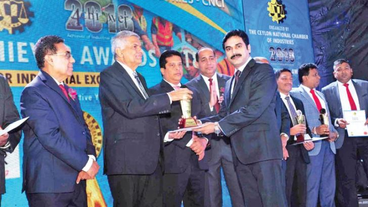 Associated Battery Manufacturers (Ceylon) Limited (ABM) Director/CEO, M Ramachandran receiving the Gold Award for Industrial Excellence and CNCI top 10 Award from Prime Minister Ranil Wickremesinghe at CNCI Achiever Awards ceremony held in Colombo recently.  Pictures by Chaminda Niroshana