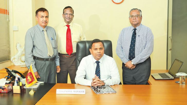 Palitha Gamage after assuming his new position as GM/CEO of HDFC Bank. Bank Chairman, R.J.De Silva, former CEO/GM, S.Dissanayake and COO, M.K.Nambiyarooran look on
