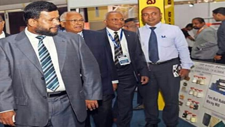Minister Rishad Bathiudeen and others at the IDB stall.