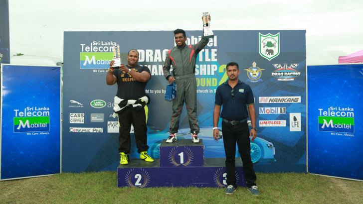 Hiran Kevitiyagala (Middle) winner of the Pro Drag Open race and runner-up Darin Weerasinghe clebrating on the podium (Right) Shehan Silva – Regional Head of Mobitel who gave away the awards.