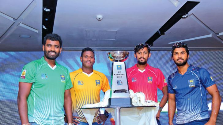 Captains Thisara Perera (Dambulla), Angelo Mathews (Kandy), Suranga Lakmal (Galle) and Dinesh Chandimal (Colombo) pose with the SLC T20 Trophy that will be awarded to the winners of the tournament.