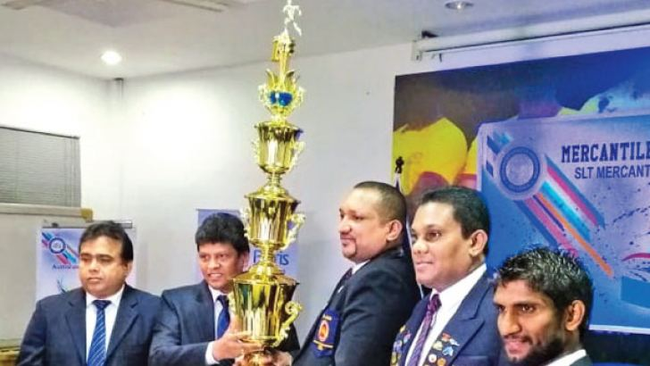 Sri Lanka Telecom CEO (Marketing) Ajantha Seneviratne hands over the championship trophy to the President of Mercantile Services Athletic Association Prasanna Indika. Sri Lanka Telecom General Manager Rohana Ellawala, Secretary of Mercantile Services Athletic Association Tonado Jayasundara is also present.