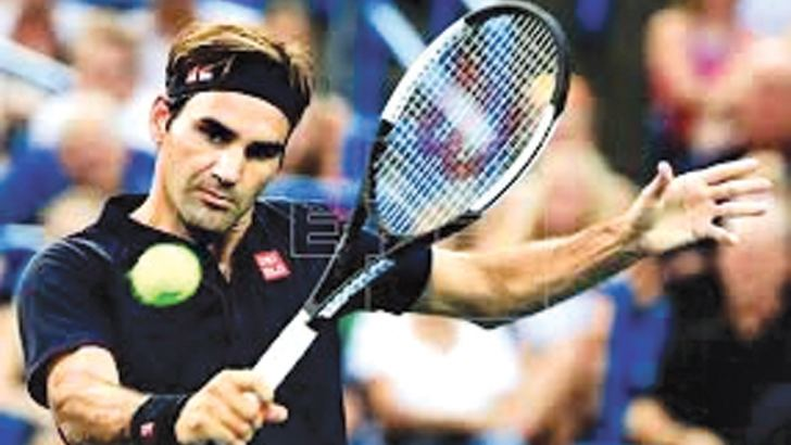 Roger Federer of Switzerland in action against David Goffin of Belgium in their semifinal match at Cincinnati.