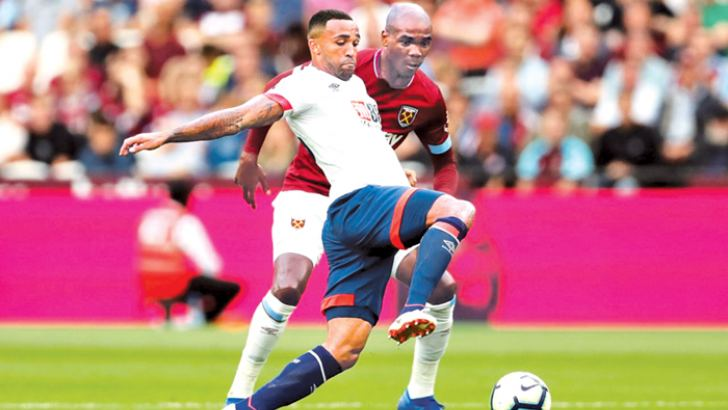 West Ham's Angelo Ogbonna in action with Bournemouth's Callum Wilson.