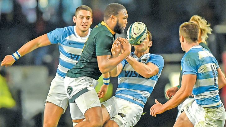 South Africa's outside centre Lukhanyo Amm(2L) clashes with Argentina's scrum-half Gonzalo Bertranou (2R) during the Rugby Championship rugby union match at Johnson Kings Park Stadium in Durban on Saturday. – AFP
