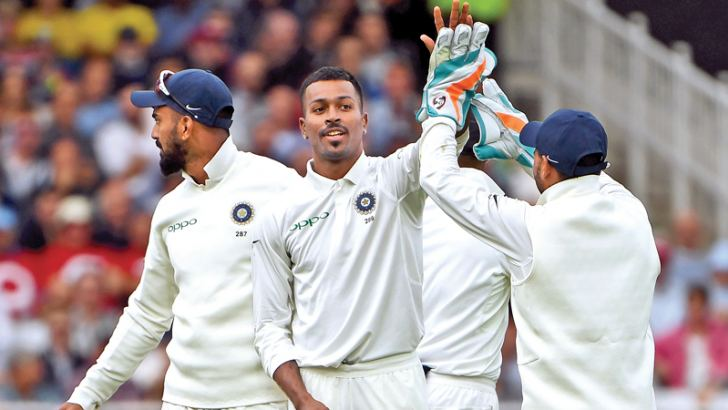 India's Hardik Pandya (C) celebrates with teammates after taking his fifth wicket, that of England's Stuart Broad during play on the second day of the third Test cricket match between England and India at Trent Bridge in Nottingham, central England on August 19. AFP