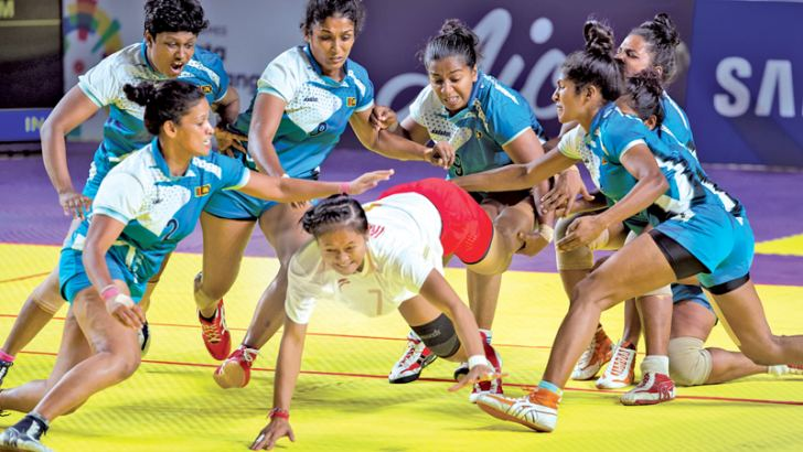 Sri Lanka women's team in action against host Indonesia in their kabbadi match which they won 34-17 at the 18th Asian Games in Jakarta yesterday.