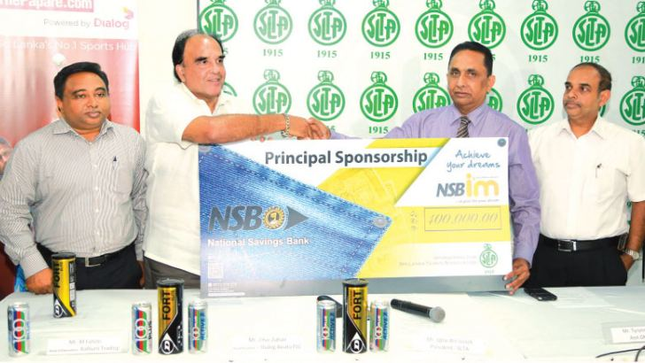 Assistant General Manager of National Savings Bank (NSB) - Tyronne Gomis (third from left) hands over the sponsorship cheque to the President of Sri Lanka Tennis Association (SLTA) - Iqbal Bin Issack (second from left). Dialog Axiata PLC, Head of Content - Zihar Zuhair (left) and General Secretary of SLTA Pradeep Goonesekera are also present. Picture by Shan Rambukwella