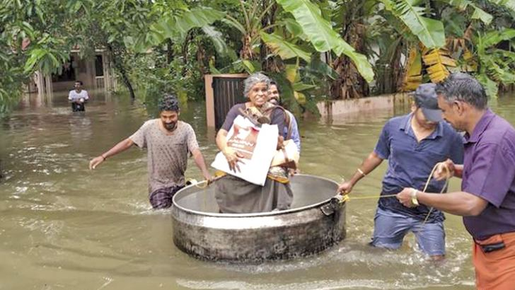 Helping those marooned by the floods.