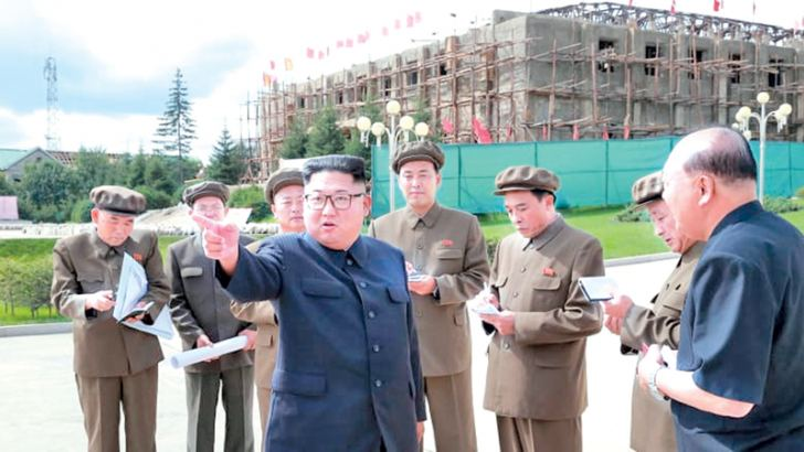 Kim Jong-un visits a construction site during a visit to the city of Samjiyon.