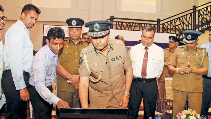 IGP Pujith Jayasundara launches the Facebook page. Pictures by Sulochana Gamage