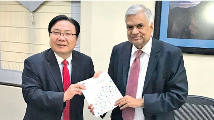 Asian Development Bank (ADB) Vice President (Operations 1), Wencai Zhang presenting a report to Prime Minister Ranil Wickremesinghe yesterday