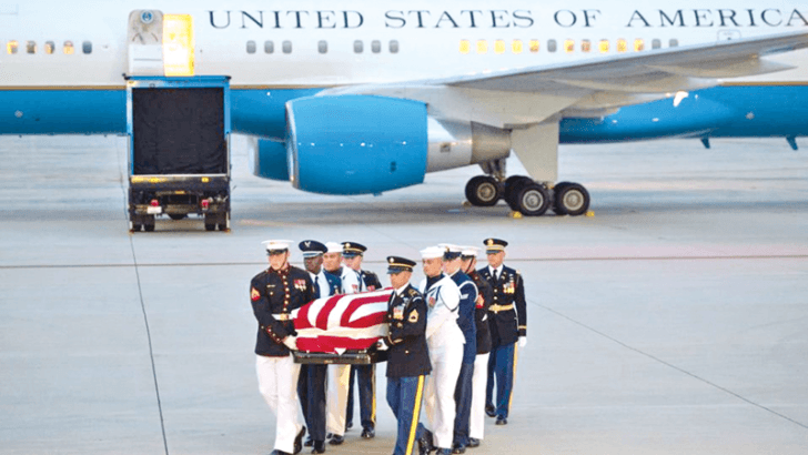 The flag-draped casket of the late US Senator John McCain, Republican of Arizona, arrives on a military airplane at Joint Base Andrews in Maryland. - AFP