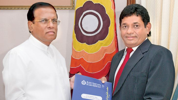Roshan Gunawardena received his appointment from President Maithripala Sirisena, at the President's Office yesterday. Picture courtesy President's Media Division