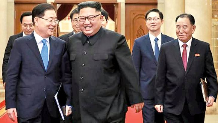 North Korean leader Kim Jong-un with South Korean President's Special Envoy Chung Eui-yong in Pyongyang. - AFP