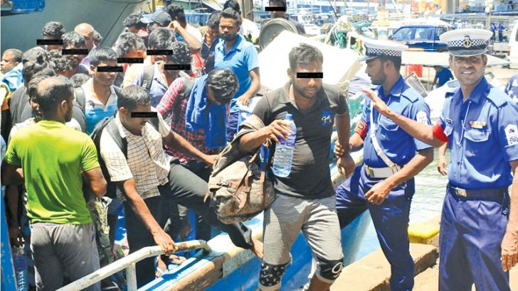 Navy personnel helping the illegal immigrants at the Colombo harbour.