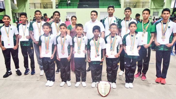 Boys' champion St.Johns Nugegoda team with the coach, Arosha Weerasinghe