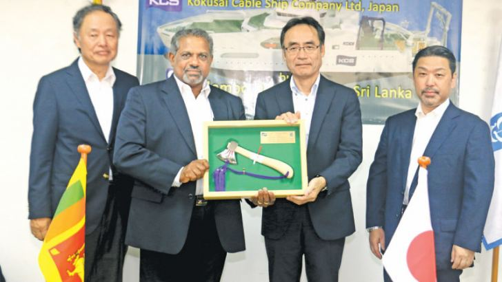 """D.V. Abeysinghe MD/CEO Colombo Dockyard PLC presenting the symbolic axe used to launch the Cable Laying Vessel """"KDDI CABLE INFINITY"""", flanked by Dr. Toru Takehara Chairman CDPLC and Yukihiro Fujii Managing Director KCS"""