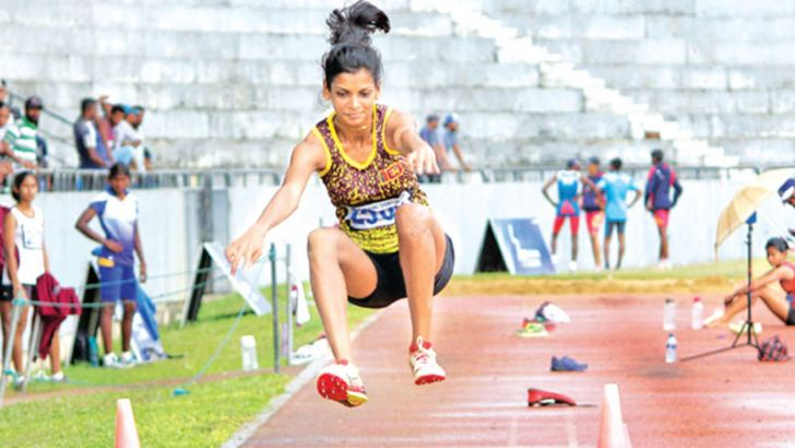Private H.D.V Lakshani of the Sri Lanka Army Women's Corps creates a new national triple jump record pf 13.58 meters at the Defense services meet yesterday.
