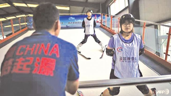 Hospital staff undergo training on a skiing simulator at the Yanqing sports school in Beijing. - AFP