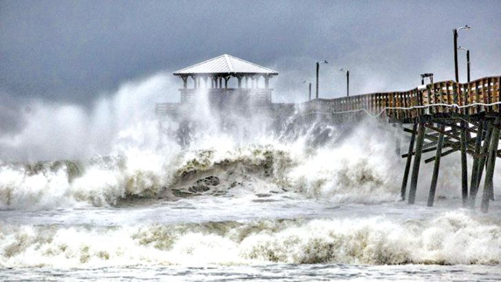 Waves slam the Oceana Pier and Pier House Restaurant in Atlantic Beach, North Carolina as Hurricane Florence approached the area.