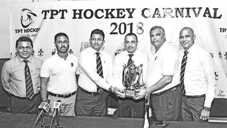 Here the trophy is being handed over by the Chairman TPT Thiran Thenabadu (4th from left) to the President Old Peterites Hockey Association Ravika De Silva (3rd from left) while from (left to right) Amitha Abeynaike - President Old Thomians Hockey Association, Roshan Krishnanalan - Assistant Secretary Trinity Hockey Foundation, Deva Ellepola - President Trinity Hockey Foundation and Lakshan Amarasekera - Secretary Old Peterites Hockey Association look on. Picture by Herbert Perera