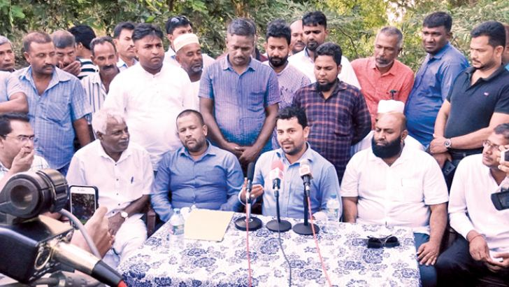 Newly-appointed Eastern Province ACMC Youth Organiser S.M.M. Musarraf addressing the media during the event, while Minister Rishad Bathiudeen and others look on. Picture by I.L.M. Rizan, Addalaichenai Central Corr.