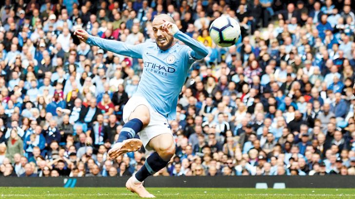 Manchester City's David Silva scores their second goal against Fulham.