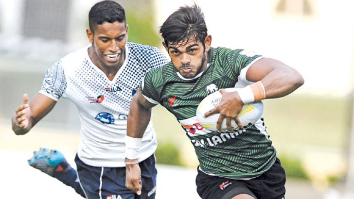Sri Lanka ruggerite Naveen Henakankanamge on his way to score a try against Philippines. Picture by Thusith Wjedoru