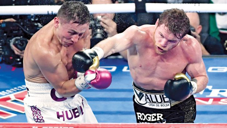 Canelo Alvarez (R) throws a right punch at Gennady Golovkin in the fifth round of their WBC/WBA middleweight title fight at T-Mobile Arena on September 15, 2018 in Las Vegas, Nevada.