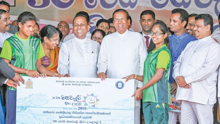 President Maithripala Sirisena presenting a cheque to a winning team. Minister Mahinda Amaraweera and others are present. Picture by President's Media Division.